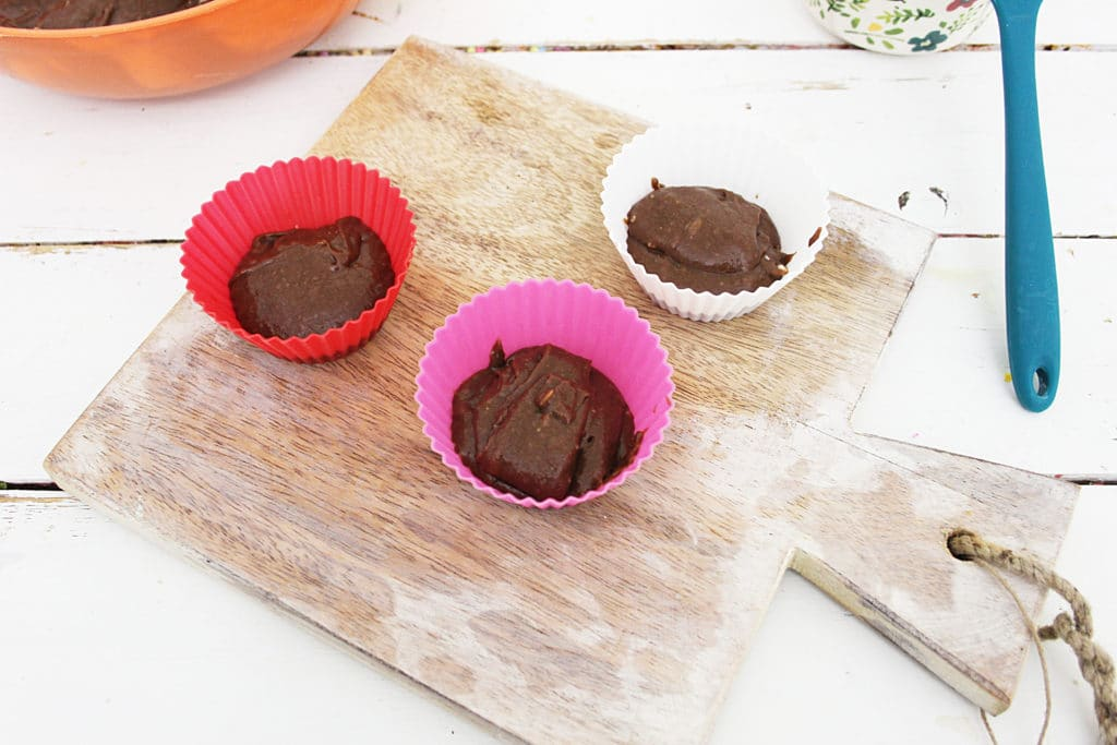 brownie batter in cup molds