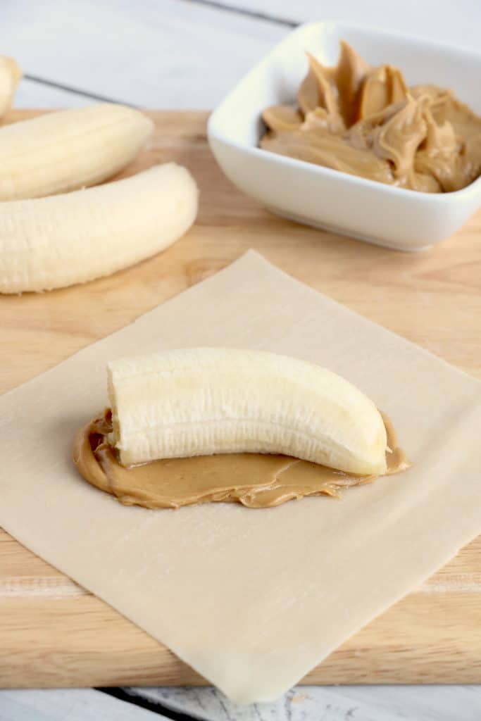 banana and peanut butter on an egg roll wrapper