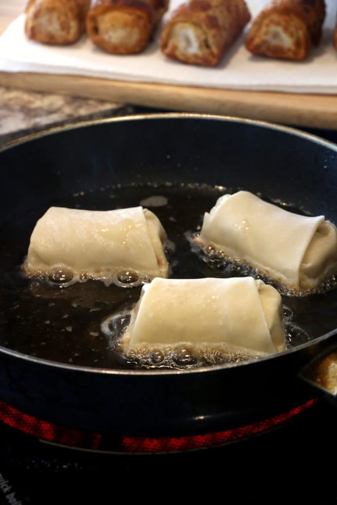 dessert egg rolls frying in a pan