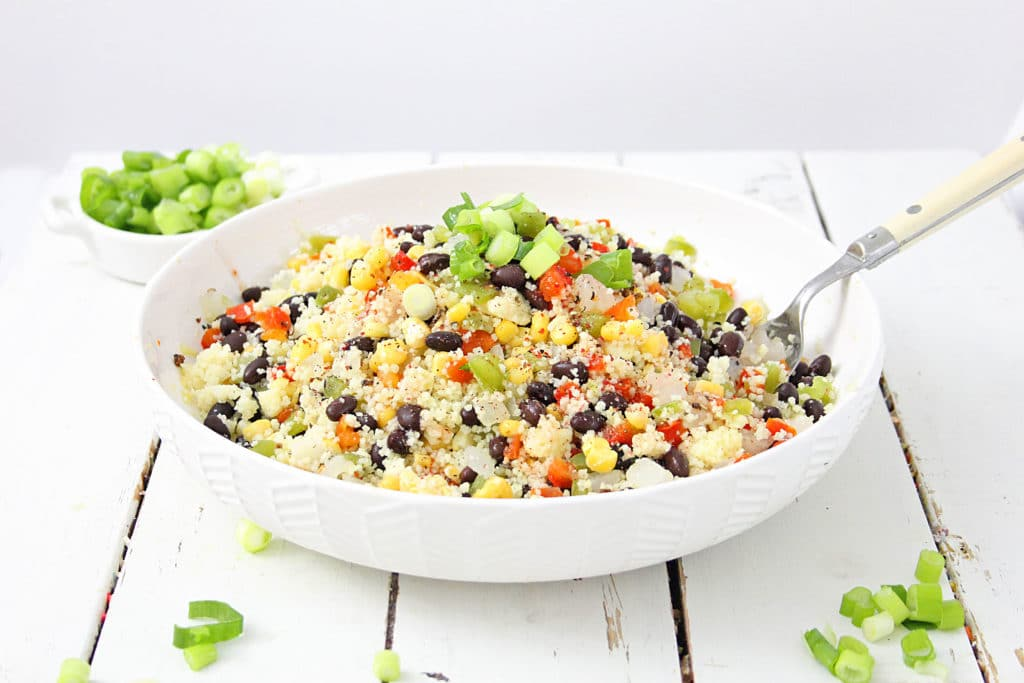 couscous salad in a white bowl