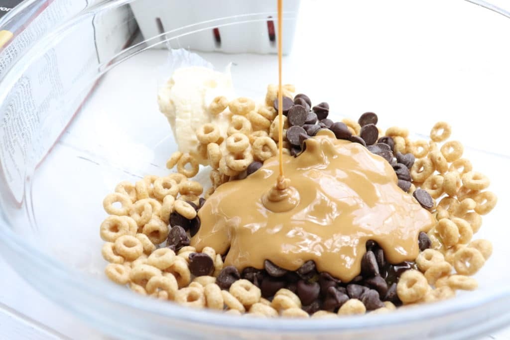 cereal, chocolate chips, peanut butter drizzled in a bowl