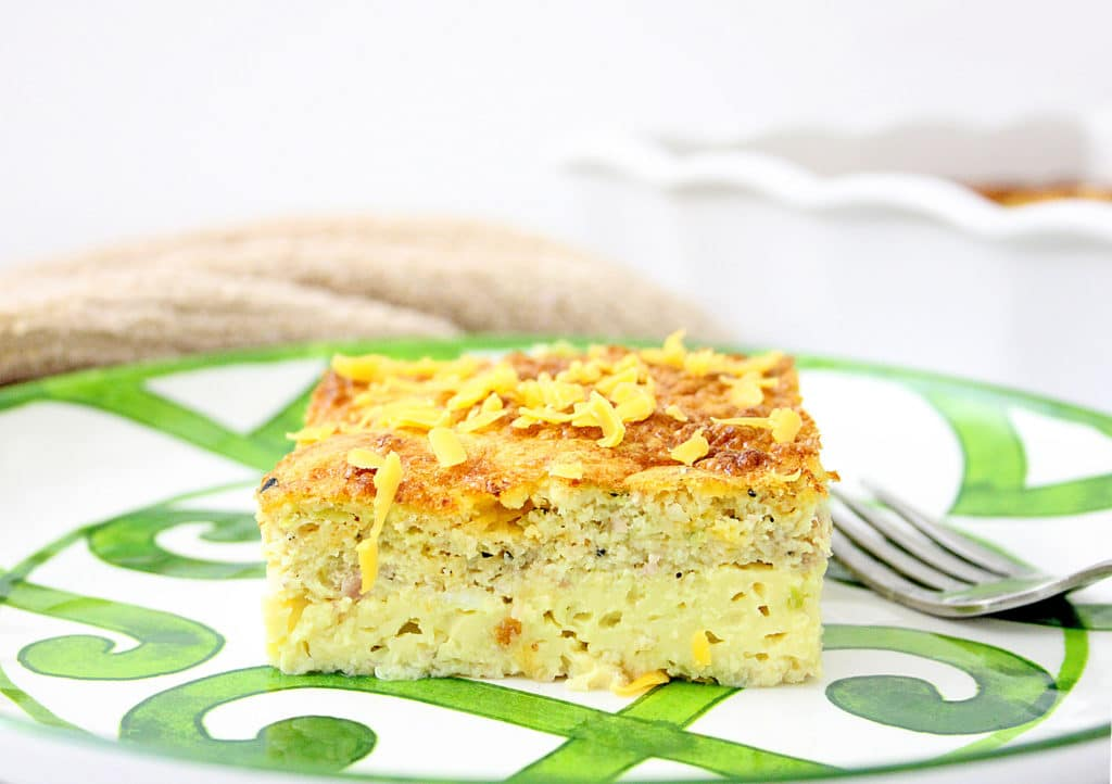 piece of egg casserole on a green and white plate