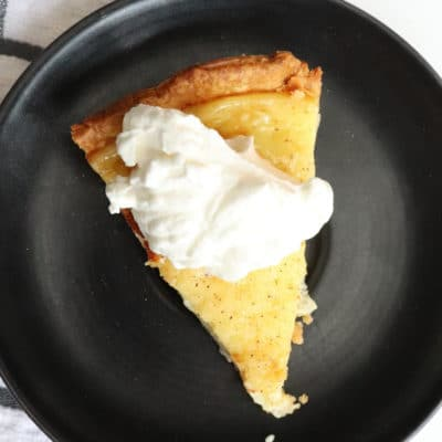 overhead shot of egg custard pie with whipped cream