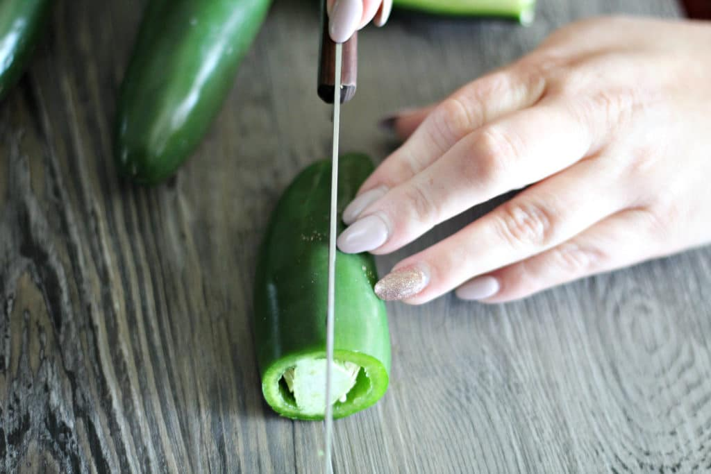 jalapeno peppers being cut