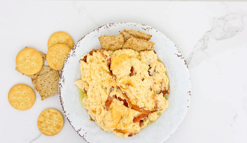 overhead picture of Bacon Cheddar Ranch Dip in a white bowl with crackers