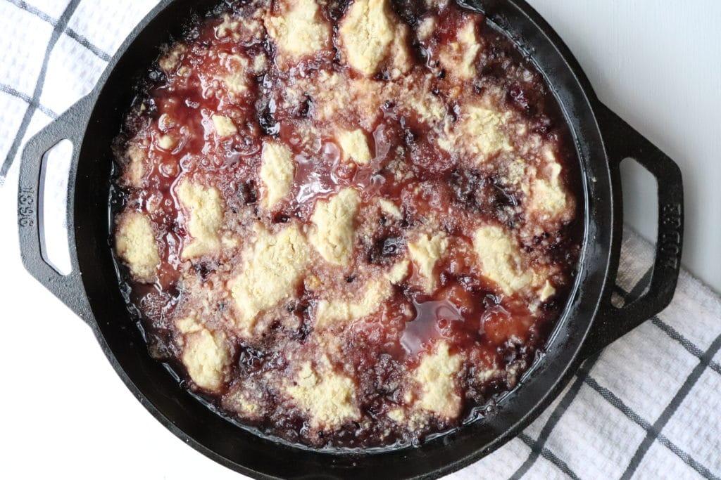 blackberry crisp in a cast iron pan