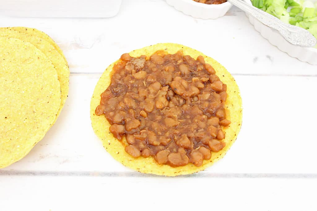 chicken and bean mixture on tostada