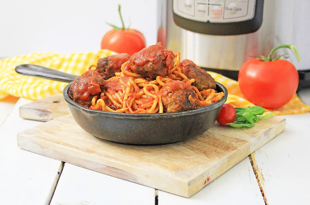 Pressure Cooker Spaghetti and Meatballs in a cast iron skillet