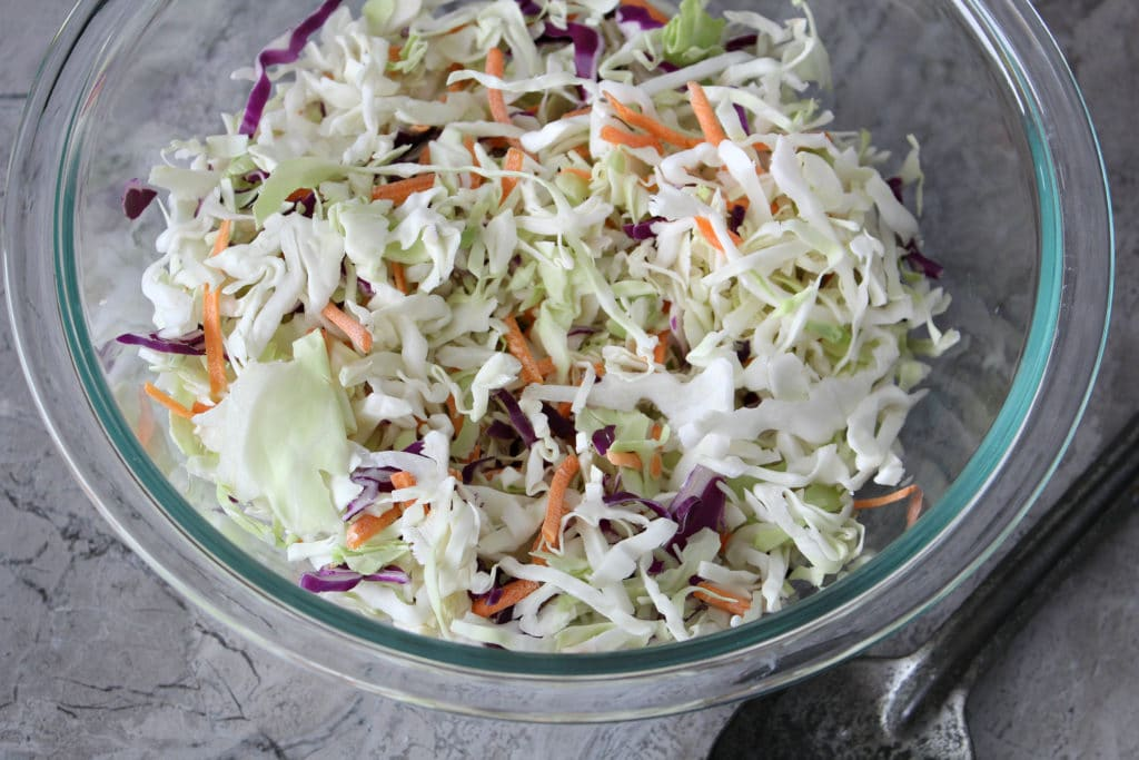 shredded carrots and cabbage in a bowl