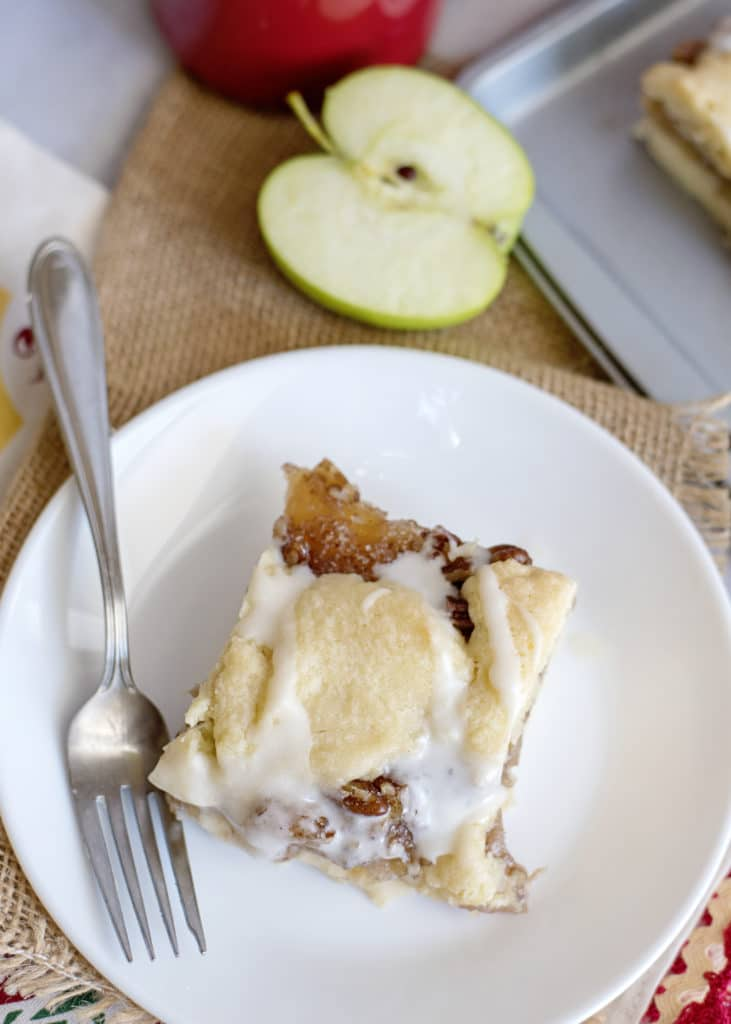 slice of apple pie bar with pecans