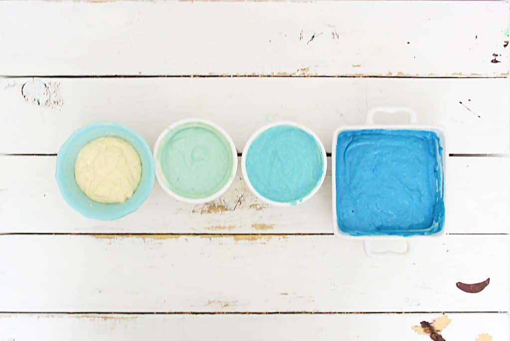 bowls of pancake batter dyed blue