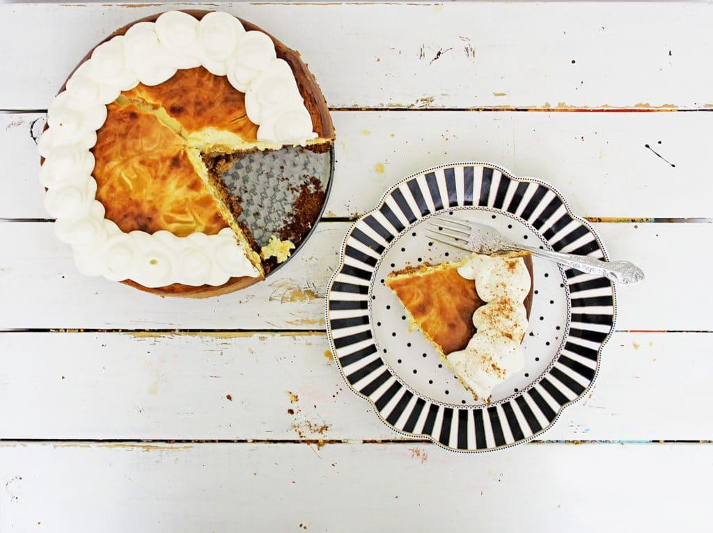 pumpkin cheesecake on a striped plate