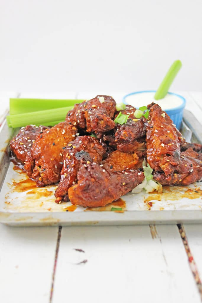 baked wings on a white plate