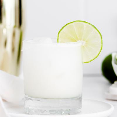 glass full of coconut margarita